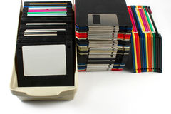 Floppy discs isolated. Floppy discs in stacks and in a box, isolated on white Royalty Free Stock Photography