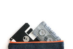 Floppy disk and audio tape cassette in bag Royalty Free Stock Photography