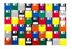 Floppy Disk Background All Fronts. Horizontal shot of a group of multicolored plastic diskettes laid into a solid background.  All fronts.  White background Royalty Free Stock Image