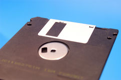 Floppy disk,black floppy blue background Stock Image
