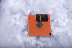 Floppy disk in a clouds Stock Photos
