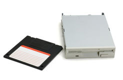 Floppy disk and drive. Black floppy disk and grey drive isolated on pure white background stock photos