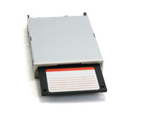 Floppy disk and drive. Black floppy disk and grey drive isolated on pure white background Royalty Free Stock Photo