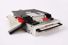 Floppy disk and drive. And data line with white background royalty free stock image
