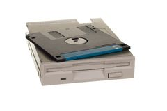 Floppy disk drive with diskettes. Isolated over white Royalty Free Stock Images