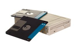 Floppy disk drive with diskettes. Isolated over white Stock Photos
