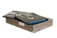 Floppy disk drive with diskettes. Isolated over white Stock Photography