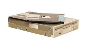 Floppy disk drive with diskettes. Isolated over white Stock Image