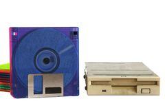 Floppy disk drive and diskettes on white background. Old technology and legacy industrial computer equipment Stock Photos