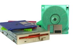 Floppy disk drive and diskettes on white background. Old technology and legacy industrial computer equipment Stock Image