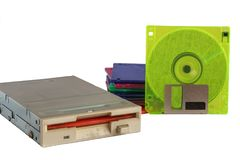 Floppy disk drive and diskettes on white background royalty free stock photography