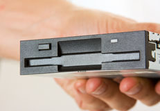 Floppy disk drive in hand Royalty Free Stock Photography