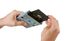 Floppy disk drive in hand Stock Photo