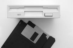 Floppy disk and drive on white background Stock Images