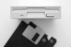 Floppy disk and drive on white background Stock Image