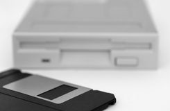 Floppy disk and drive on white background Royalty Free Stock Photography