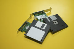 Floppy disk magnetic computer and electronic circuit board put on a  yellow desk background.selective focus. Royalty Free Stock Images