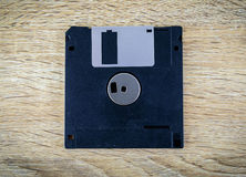 Floppy Disk magnetic on a wooden table Royalty Free Stock Photos