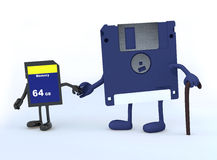 Floppy disk and memory stick that walk Stock Image