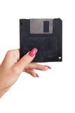 Floppy disk in vrouwelijke hand Stock Afbeelding