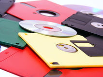 Floppy disks. Background with floppy disks and optical discs Royalty Free Stock Photo