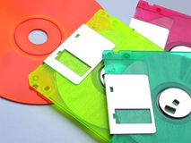 Floppy disks and a cd. Colored cd and multi-colored floppy discs stock photo
