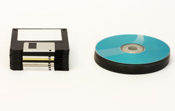 Floppy disks and CD / DVD - disk wheels on a white background Royalty Free Stock Photo