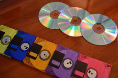 Floppy disks and CD's. Floppy disks, and cd roms, showing progression of technology Royalty Free Stock Image
