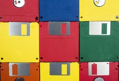 Floppy Disks Close-up. Horizontal close-up shot of nine multicolored plastic diskettes.  Shows fronts and backs of disks Stock Photos