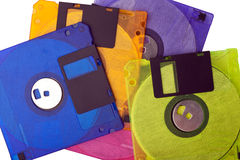 Floppy Disks Screen Stack. Colored floppy disks scattered and stacked on white background Stock Photos