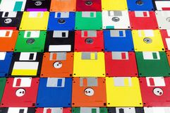 Floppy Disks Shot on an Angle. Horizontal close-up angled shot of a group of multicolored plastic diskettes.  Some fronts some backs Royalty Free Stock Image