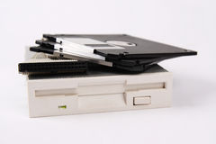 Floppy drive. A floppy drive and some floppy diskette with white background stock photography