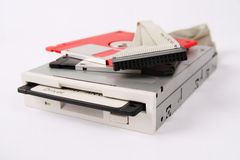 Floppy drive and disk. Floppy disk and drive and data line with white background royalty free stock photos