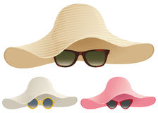 Floppy hat sunglasses. A selection of floppy hats and sunglasses Stock Photo