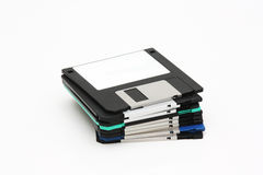 Floppy pile. A pile of obsolete floppy technology diskettes royalty free stock photos