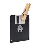 Floppy and wooden clothespin Royalty Free Stock Images