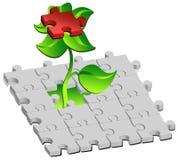 Flor con rompecabezas rojos Imagenes de archivo