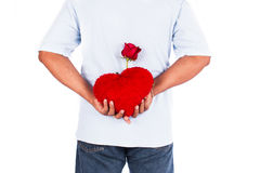 Flor cor-de-rosa da posse do homem atrás para a surpresa sua esposa Imagem de Stock Royalty Free