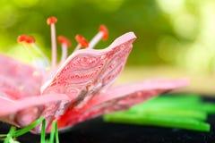 Flor cor-de-rosa um lírio de um papel fotos de stock royalty free