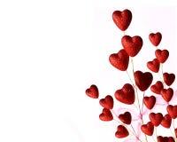 Flor de corazones rojos en el fondo blanco Imagen de archivo libre de regalías