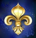 Flor de lis do ouro em um fundo azul Foto de Stock Royalty Free