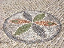 Flor de piedra, mosaico de los guijarros del mar fotografía de archivo