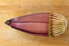 Flor del plátano en el fondo de madera Fotos de archivo
