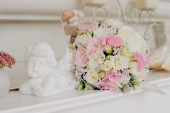 Flor do casamento com anjo perto da flor Fotos de Stock Royalty Free