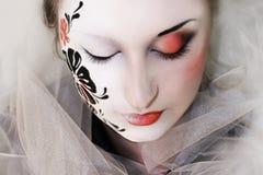 Flor en su cara Fotografía de archivo libre de regalías