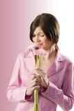 Flor que huele Foto de archivo libre de regalías