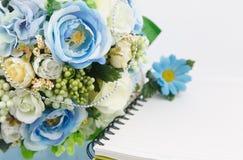 Flor y cuaderno Foto de archivo