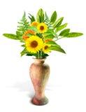 Flor y hoja en florero Foto de archivo libre de regalías