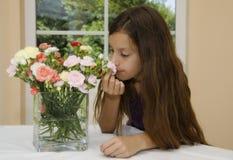 Flor y muchacha Imagen de archivo