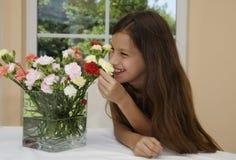 Flor y muchacha Imagenes de archivo